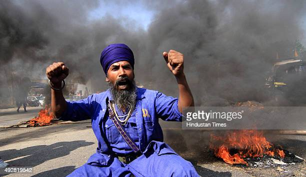 Sikh shouting slogans against Punjab Chief Minister Parkash Singh Badal during a protest against the killing of two Sikh boys on October 15 2015 in...