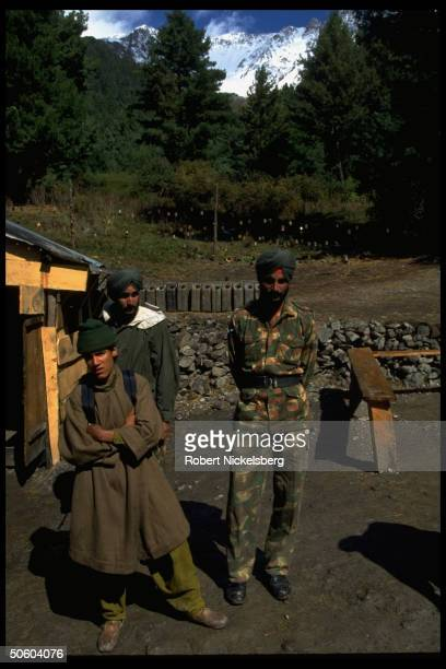 Sikh soldiers local boy prob at Indian Army base camp in Shamsharbara mts bordering Pakistan Kashmir