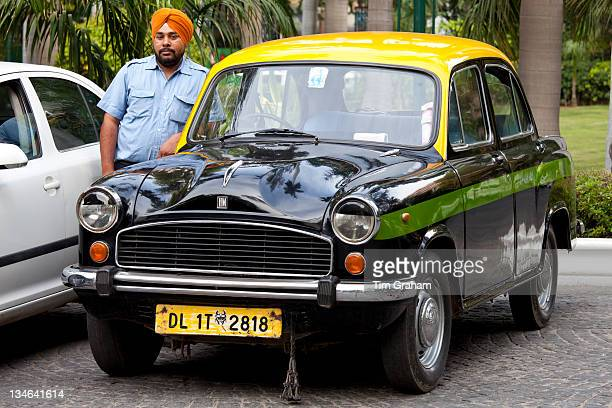 Sikh taxi driver with classic Ambassador taxi at The Imperial Hotel New Delhi India