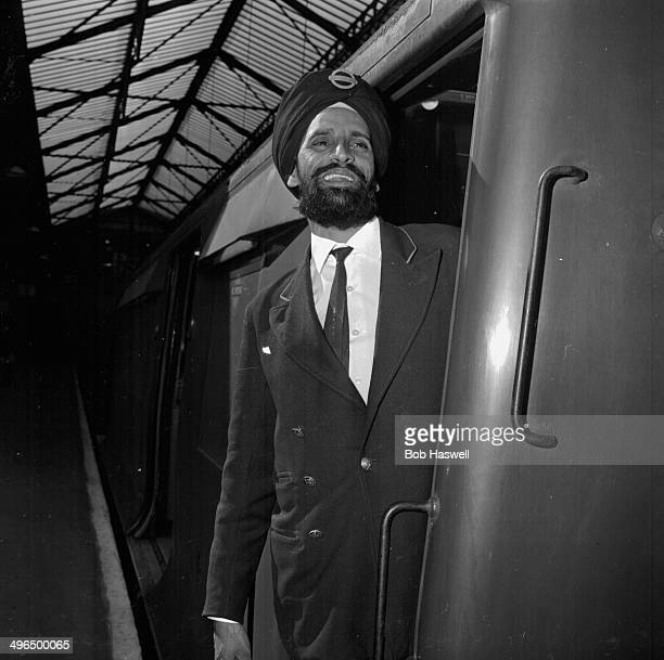 Sikh train driver Amar Singh smiling as he is allowed to wear his turban to work for the first time London September 2nd 1964