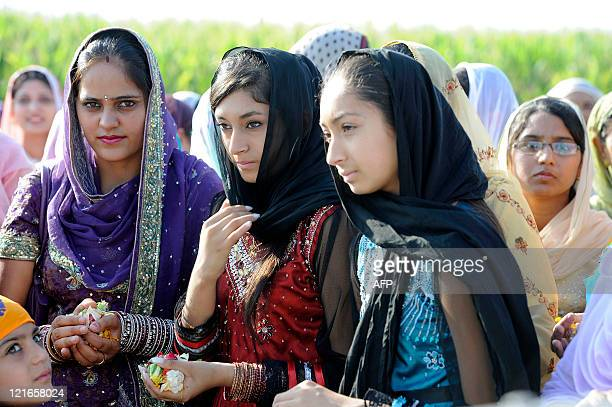 Sikh women participate in the inauguration ceremony of a major new temple on August 21 in Italy's farming heartland in the Po River Valley where many...