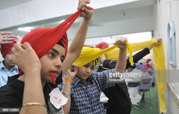 Sikh youth participating in a turban tying competition held at Sarabha Nagar Gurudwara on the occasion of Baisakhi festival on April 13 2017 in...