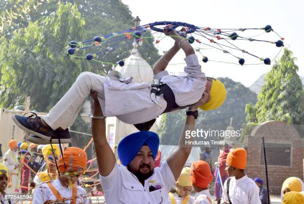 Sikh youth perform the Sikh martial art known as 'Gatka' during procession on the eve of Martyrdom Day of Guru Tegh Bahadur outside Golden Temple on...