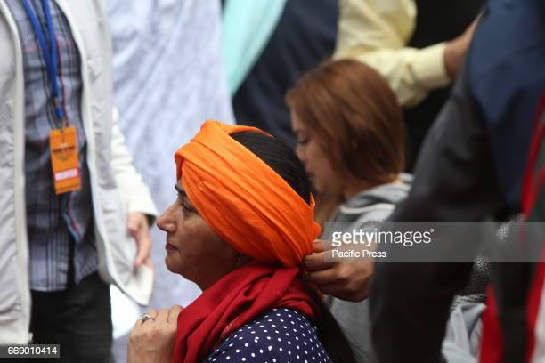 Sikhs of New York arranged for Turban Day in Times Square Volunteers were on hand to help tie traditional Sikh turbans for all comers some followers...