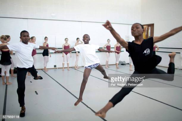 Sikhumbuzo Hlahleni age 15 trains jumps with other students at Cape Town City Ballet's youth company on March 6 2010 in Cape Town South Africa He...