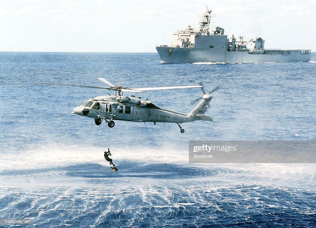 Sikorsky MH-60S Knighthawk retrieving soldier from Atlantic Ocean