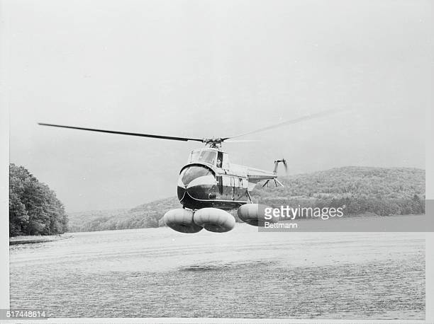 A Sikorsky S55 helicopter equipped with new Kidde Inflatair donutshaped flotation gear makes a simulated emergency landing on water The 58 cubic inch...