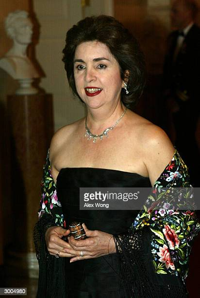 Sila M Calderon Governor of Puerto Rico arrives for a dinner hosted by President George W Bush and first lady Laura Bush February 22 2004 at the...