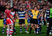 Sila Puafisi of Gloucester receives a red card from referee Tim Wigglesworth during the Aviva Premiership match between Gloucester and Bath at...