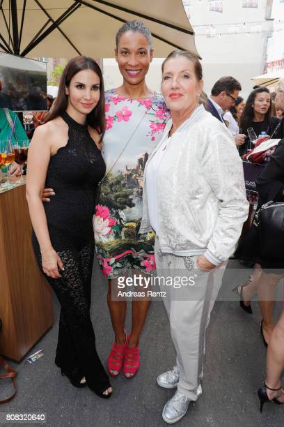 Sila Sahin Annabelle Mandeng and Katy Karrenbauer attend the after show reception during the Riani Fashion Show Spring/Summer 2018 at Umspannwerk...