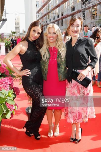 Sila Sahin Jennifer Knaeble and Maike von Bremen attend the Riani Fashion Show Spring/Summer 2018 at Umspannwerk Kreuzberg on July 4 2017 in Berlin...