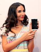 Sila Sahin poses with a Blackberry Z10 smartphone at the Blackberry Style Lounge during MercedesBenz Fashion Week in Berlin on July 3 2013 in Berlin...