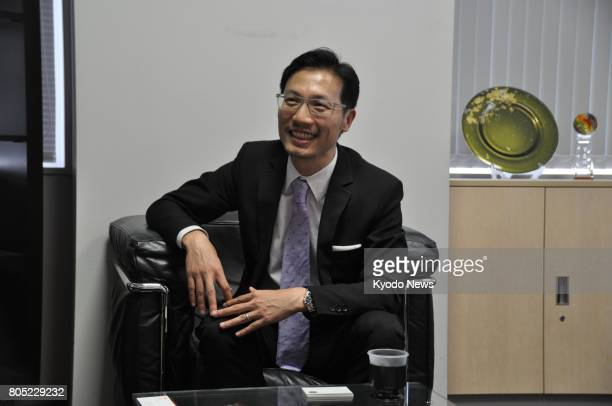 Silas Chu director of Hong Kong Trade Development Council's Japan office speaks in an interview with Kyodo News on June 30 at his office in Tokyo...