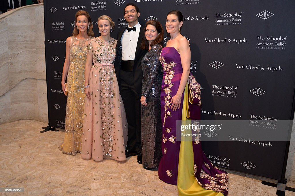 Silas Farley, apprentice with New York City Ballet, center, poses for a photograph with chairpersons of the School of American Ballet Winter Ball, Julia Koch, from left, Jenny Paulson, Laura Zeckendorf and Diana DiMenna during the School of American Ballet Winter Ball at the the David H. Koch Theater in New York, U.S., on Monday, March 11, 2013. The School of American Ballet Winter Ball took place at the Lincoln Center. Photographer: Amanda Gordon/Bloomberg via Getty Images