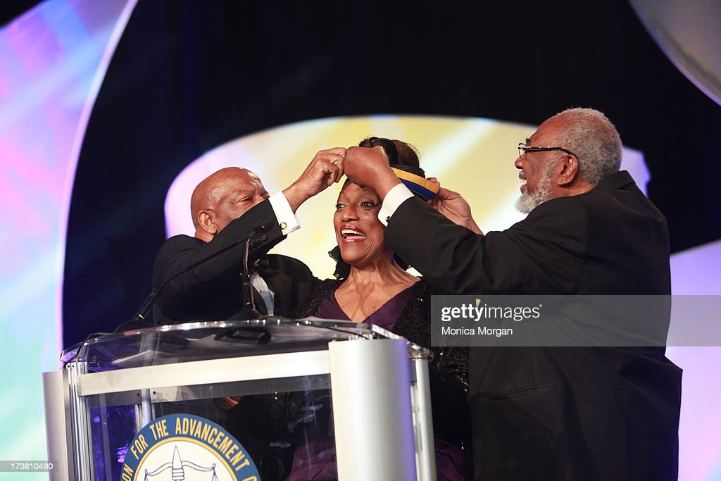Silas Norman, <a gi-track='captionPersonalityLinkClicked' href=/galleries/search?phrase=Jessye+Norman&family=editorial&specificpeople=239491 ng-click='$event.stopPropagation()'>Jessye Norman</a> and John Lewis attend the 104th Annual NAACP Convention Spingarn Awards at the Hilton Hotel on July 17, 2013 in Orlando, Florida.
