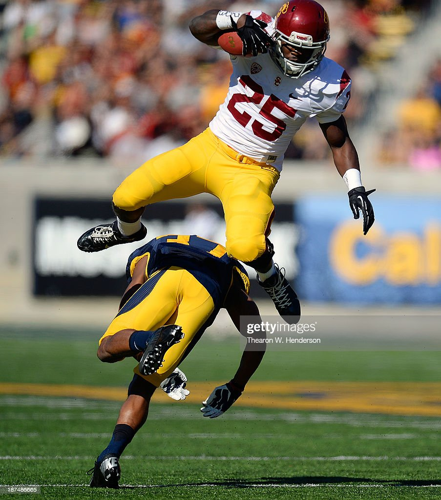<a gi-track='captionPersonalityLinkClicked' href=/galleries/search?phrase=Silas+Redd&family=editorial&specificpeople=7197236 ng-click='$event.stopPropagation()'>Silas Redd</a> #25 of the USC Trojans leaps over would be tackler Cedric Dozier #37 of the California Golden Bears during the first quarter at California Memorial Stadium on November 9, 2013 in Berkeley, California.