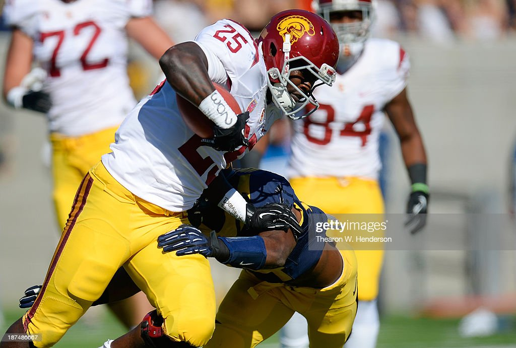 Silas Redd #25 of the USC Trojans scores on an eight yard touchdown run against the California Golden Bears during the first quarter at California Memorial Stadium on November 9, 2013 in Berkeley, California.