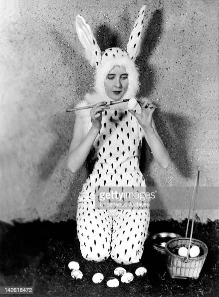 Silent film actress Patricia Avery painting Easter eggs for children who are emplyed in the movies Hollywood California January 30 1927