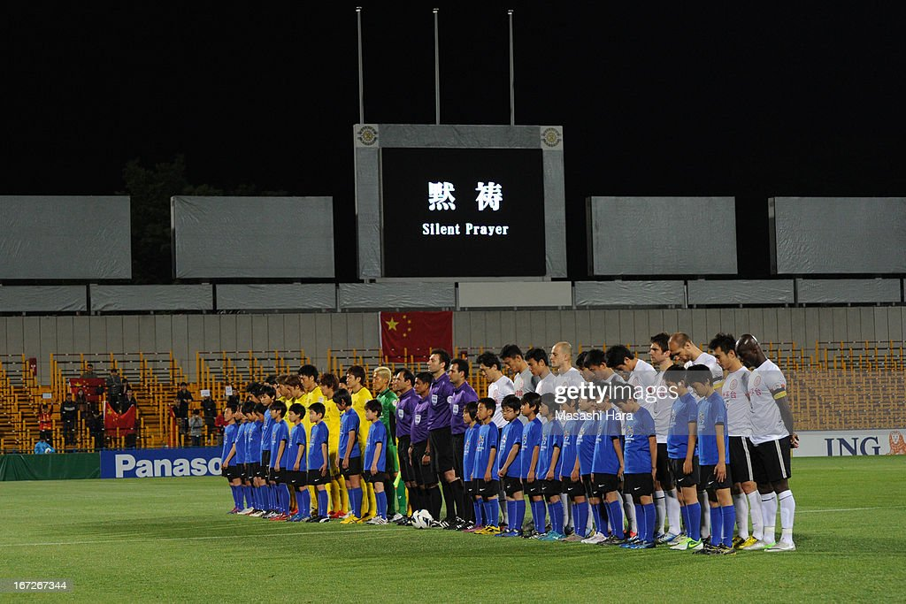 Silent prayer prior to the AFC Champions League Group H match between Kashiwa Reysol and Guizhou Renhe at Hitachi Kashiwa Soccer Stadium on April 23, 2013 in Kashiwa, Japan.