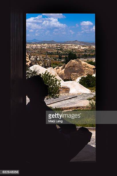 Silhouette at a cave's doorstep in Goreme National Park a UNESCO World Heritage site in Cappadocia Turkey