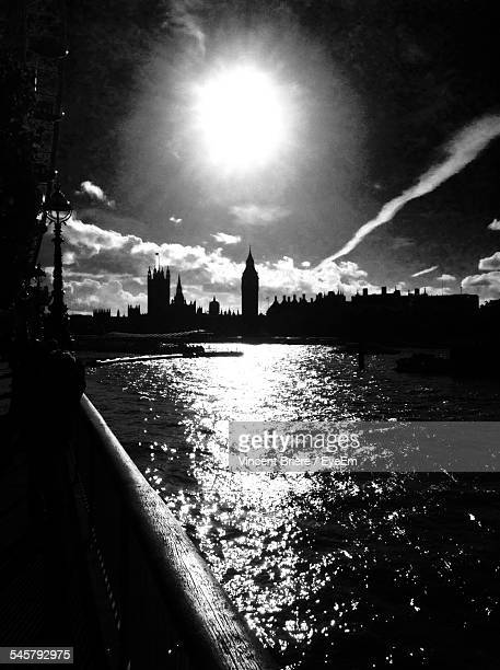Silhouette Big Ben Against Thames River On Sunny Day