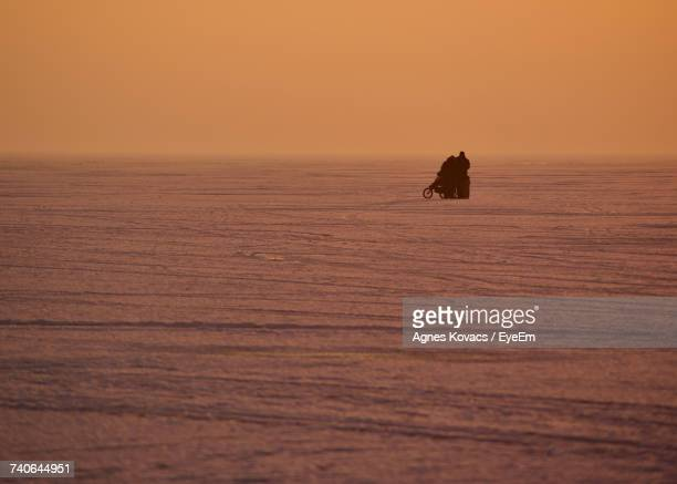 Silhouette Boat On Sea Against Sky During Sunset