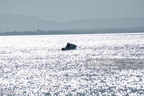 Silhouette Boat On Sea Against Sky