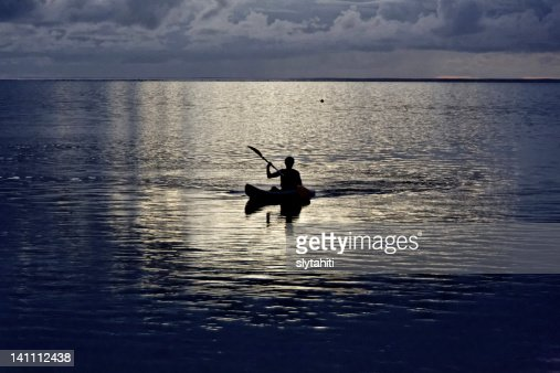 Silhouette boatman