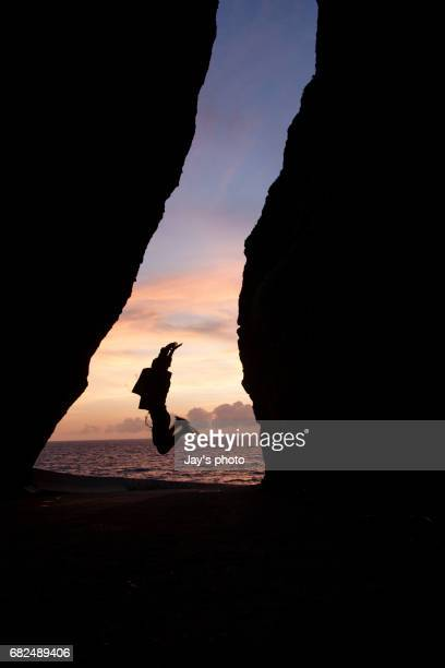 Silhouette cave with sunset