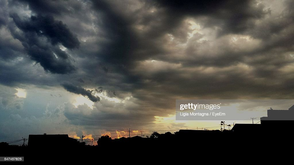 Silhouette City Against Dramatic Sky