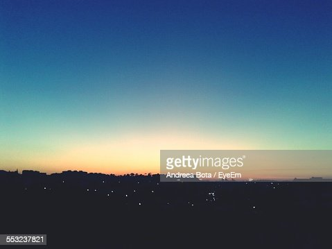 Silhouette Cityscape Against Clear Sky At Sunset