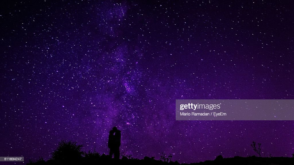 Silhouette couple against star field