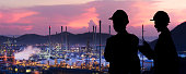 Silhouette engineers are standing orders The oil refining industry
