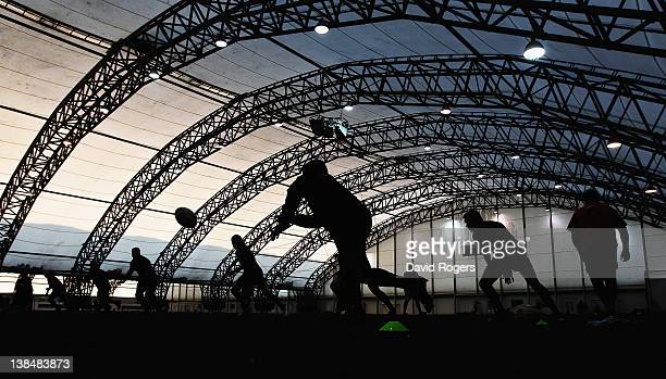 Silhouette England scrumhalf Ben Youngs passing the ball during the England training session held at the Soccer Dome on February 7 2012 in Greenwich...