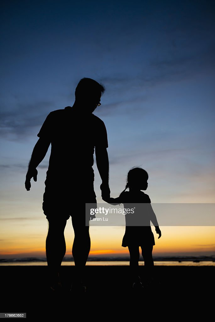 Silhouette for father and daughter : Stock Photo