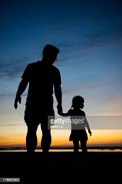 Silhouette for father and daughter
