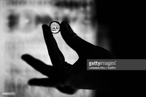 Silhouette Hand Holding Lens With Dance Text On It