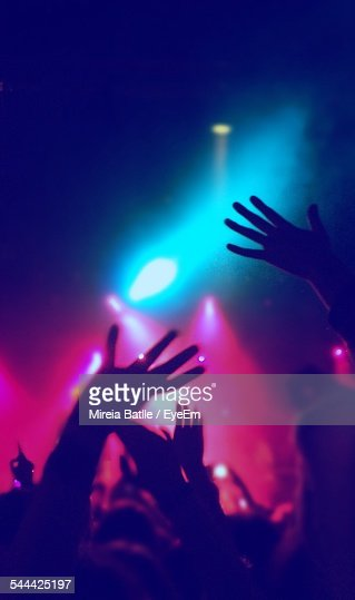 Silhouette Hand Of People Enjoying In Nightclub