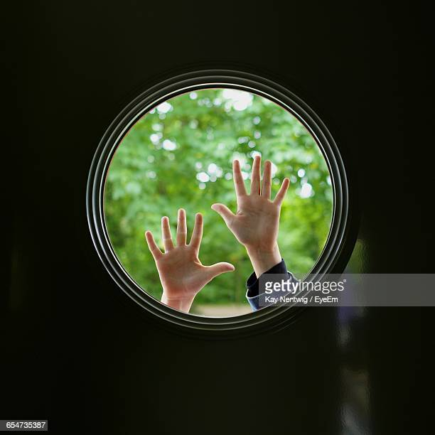 Silhouette Hands Touching Round Window