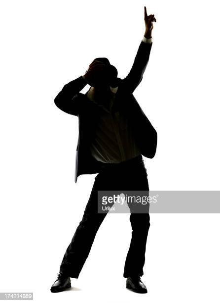 Silhouette image of young man dancing on white