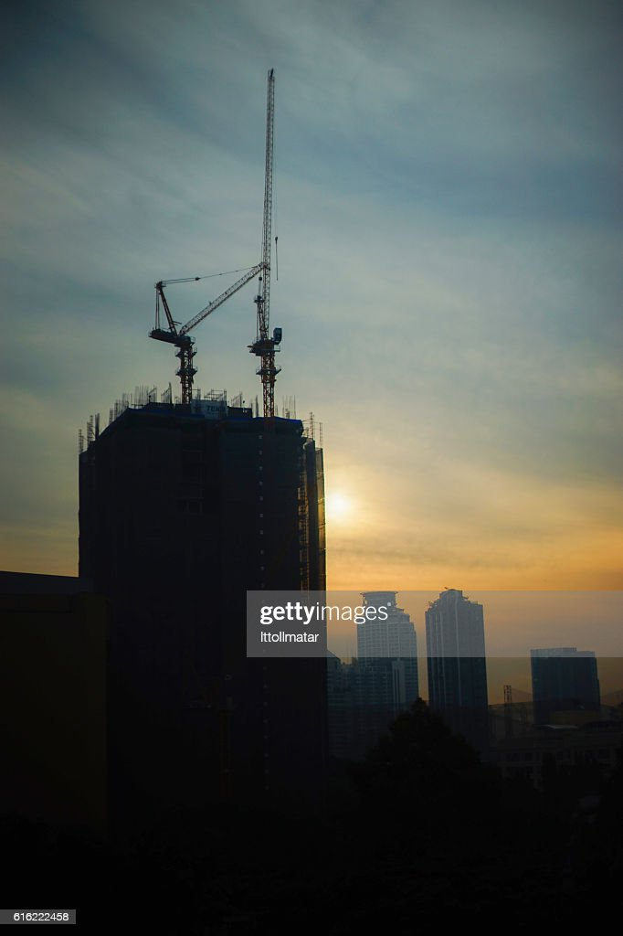 silhouette Industrial construction cranes and building : Stock Photo