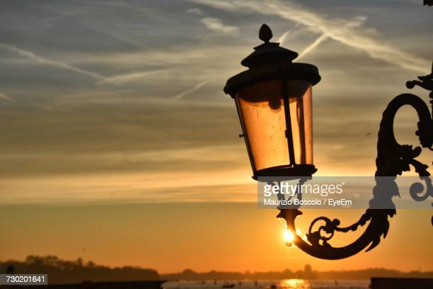 Silhouette Lamp Against Sky During Sunset