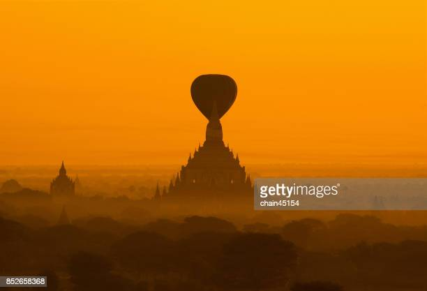 Silhouette landscape of sunrise morning and hot air balloon over ancient pagoda in Bagan, Myanmar Bagan is old Kingdom in Past of Burma.