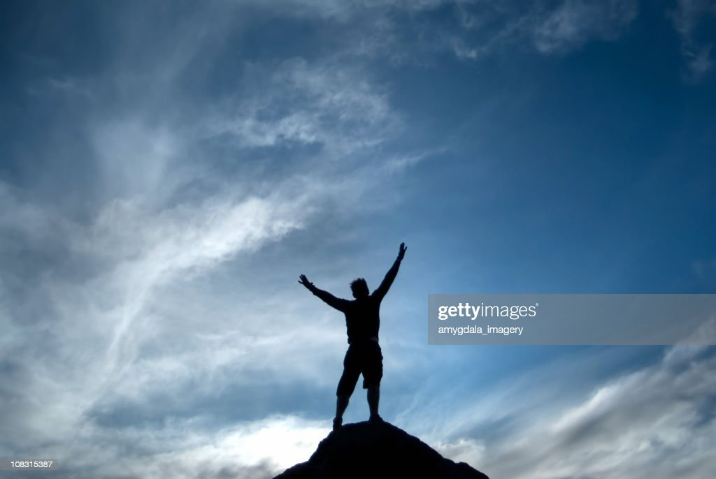 silhouette man arms raised into sky abstract : Stock Photo