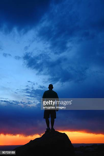silhouette man looking at sunset sky landscape