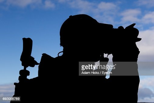 Silhouette Man Photographing Against Blue Sky