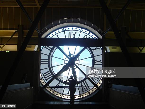Silhouette Man Standing In Clock Tower