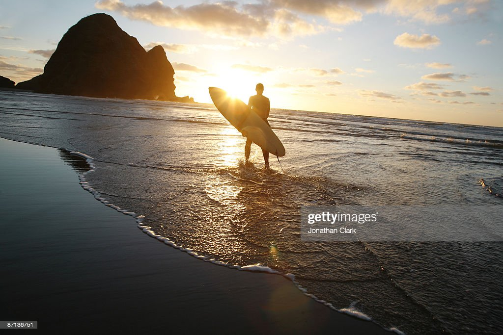 Silhouette man walking on beach : Stock Photo