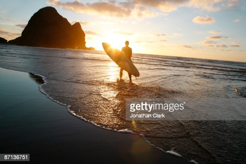 Silhouette man walking on beach : Stock Photo