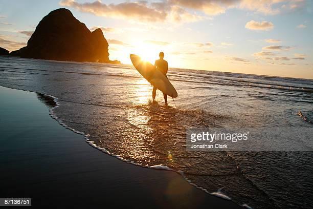 Silhouette man walking on beach